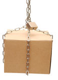 Cardboard box closed with a chain and a lock Stock Photography