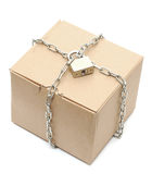 Cardboard box closed with a chain and a lock Stock Images