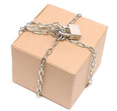 Cardboard box closed with a chain and a lock Stock Photos