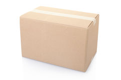Cardboard box closed with tape Stock Photos