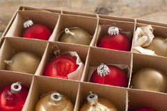 Cardboard box of colorful Christmas decorations Royalty Free Stock Photos