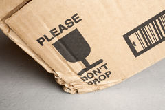 Cardboard Box Dropped Despite Warning Royalty Free Stock Photography
