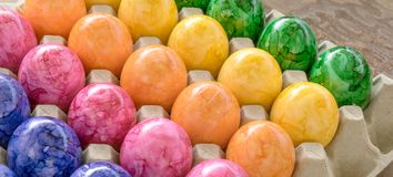 Cardboard box with easter eggs. Cardboard box with colored easter eggs royalty free stock images