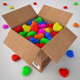 Cardboard box filled with coloured hearts Royalty Free Stock Image