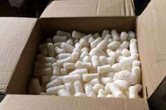 Cardboard Box Filled With Packing Peanuts Royalty Free Stock Images