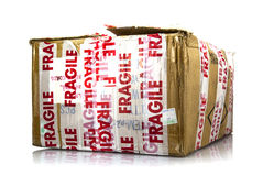 Cardboard box with fragile signs Royalty Free Stock Photos