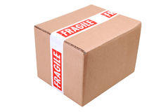 Cardboard box and fragile tape Royalty Free Stock Photos