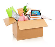 Cardboard box full with household stuff Royalty Free Stock Images