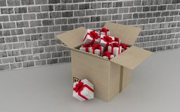 Cardboard box with gifts on brick wall background Royalty Free Stock Photography