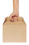 Cardboard box in hand. Isolated on white background Royalty Free Stock Photo