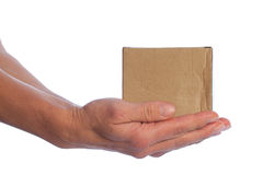 Cardboard box in hands. Royalty Free Stock Photography