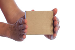 Cardboard box in hands. Stock Photo