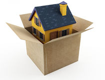 Cardboard box and house. 3d image isolated on white Royalty Free Stock Photography