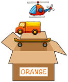 Cardboard box with label orange Royalty Free Stock Images