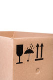 Cardboard box with mail symbols Royalty Free Stock Images