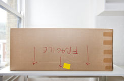 "Cardboard box marked ""fragile"" upside down Royalty Free Stock Photos"