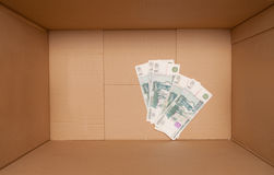 Cardboard box with money Stock Photos
