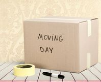 Cardboard Box labelled moving day on background. Cardboard box moving day white background object  box Stock Photos