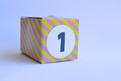 Cardboard box with the number one. Striped cardboard box with the number one printed on it Stock Photography