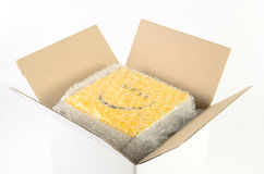 Cardboard box. Open cardboard box packaging with air bubble stock photography
