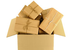 Cardboard box overflowing with lots of wrapped mail packages Stock Images