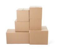 Cardboard box package moving transportation delivery stack. Close up of a stack of cardboard boxes on white background Stock Photos