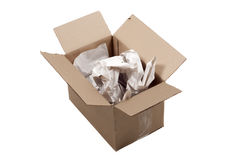 Cardboard box and packaging. Open, used cardboard box with crumpled paper inside, isolated on white royalty free stock photo