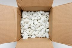 A cardboard box with packing foam pellets Royalty Free Stock Image