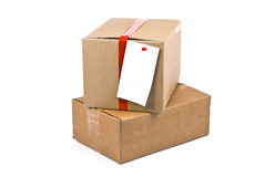 Cardboard box with pinned note Royalty Free Stock Photography