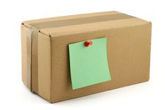 Cardboard box with pinned note Stock Image