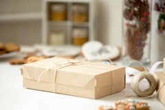 Cardboard box, postal parcel wrapped in brown kraft paper tied. With a rope, ready for delivery. Close up royalty free stock image