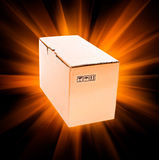 Cardboard box with rays Royalty Free Stock Photography