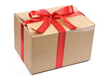 Cardboard box with red bow Stock Photo