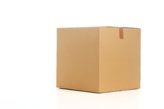 Cardboard box. Sealed cardboard box on white background Royalty Free Stock Images
