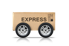 Cardboard box with signs and automotive wheels Stock Images