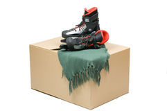 Cardboard box, skates and a scarf Stock Images