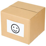 Cardboard box with a smiley sign Stock Images