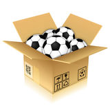 Cardboard Box with Soccer Balls Stock Images