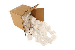 Cardboard box with spilled packing peanuts Stock Images