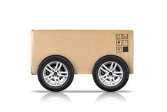 Cardboard box with standard signs and wheels  on white Royalty Free Stock Photos