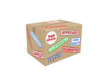 Cardboard box with stickers and stamps. Quality (fine, superior) goods concept: cardboard (carton) box with stickers and stamps as symbol of quality standards Stock Photos