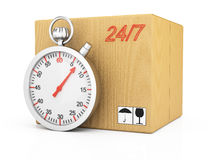 Cardboard box and stopwatch Royalty Free Stock Photography