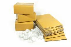 Cardboard box with styrofoam peanuts on  Stock Photos