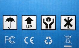 Cardboard box symbols Stock Photography