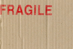 Cardboard box symbols. Fine image close-up of grunge red fragile on cardboard Royalty Free Stock Photos