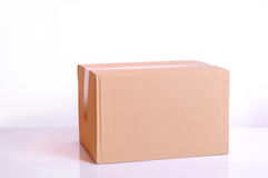Cardboard box on a table Stock Images
