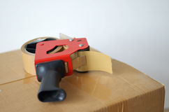 Cardboard box and tape dispenser Stock Photo