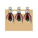 Cardboard box with three beer bottles Stock Photos