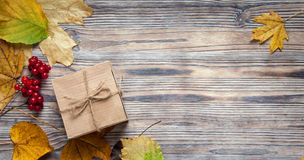 Cardboard box tied with string on a bow on a wooden background i Stock Photos