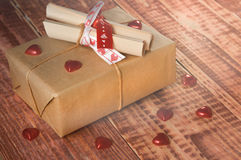 Cardboard box tied with a thread, with paper notes. Valentine's day.Cardboard box tied with a thread, with paper notes Stock Photo